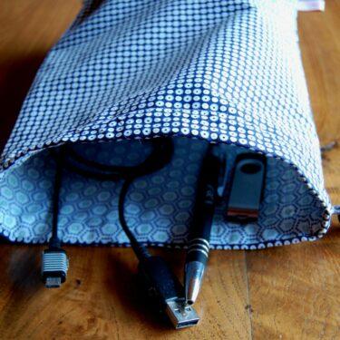 la pochette de rangement en tissu doublée